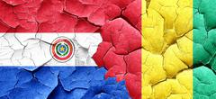 Paraguay flag with Guinea flag on a grunge cracked wall Stock Illustration