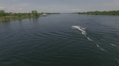 4k aerial following seadoo on lake Stock Footage