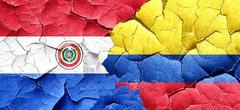 Paraguay flag with Colombia flag on a grunge cracked wall Stock Illustration