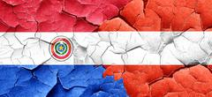 Paraguay flag with Austria flag on a grunge cracked wall Stock Illustration