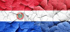 Paraguay flag with Netherlands flag on a grunge cracked wall - stock illustration