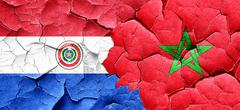 Paraguay flag with Morocco flag on a grunge cracked wall - stock illustration