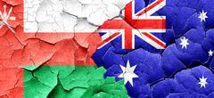 Oman flag with Australia flag on a grunge cracked wall Stock Illustration