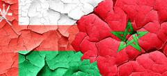 Oman flag with Morocco flag on a grunge cracked wall Stock Illustration