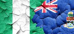 Nigeria flag with Cayman islands flag on a grunge cracked wall Stock Illustration