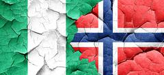 Nigeria flag with Norway flag on a grunge cracked wall Piirros
