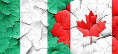 Nigeria flag with Canada flag on a grunge cracked wall Piirros