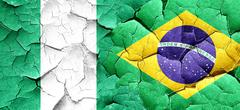 Nigeria flag with Brazil flag on a grunge cracked wall Piirros