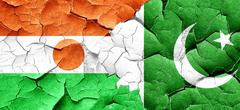 niger flag with Pakistan flag on a grunge cracked wall - stock illustration