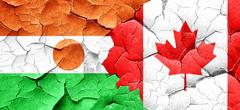 Niger flag with Canada flag on a grunge cracked wall Stock Illustration