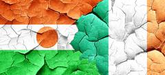 Niger flag with Ireland flag on a grunge cracked wall Stock Illustration