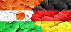 Niger flag with Germany flag on a grunge cracked wall Stock Illustration