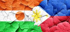 Niger flag with Philippines flag on a grunge cracked wall Stock Illustration