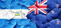 Nicaragua flag with New Zealand flag on a grunge cracked wall Stock Illustration