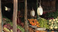 Man sells vegetables at the roadside in Nuwara Eliya, Sri Lanka. Stock Footage