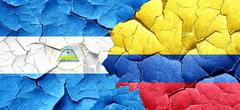 nicaragua flag with Colombia flag on a grunge cracked wall - stock illustration