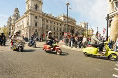 LONDON - ENGLAND 1ST MAY 2016 - Mods on their Vespa and Lambretta Scooters ri - stock photo