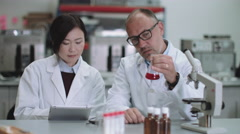 Scientist team working in laboratory - stock footage