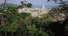 Aerial Approach Shot Through Trees Above Patong Town In Phuket Stock Footage