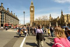 LONDON - ENGLAND 1ST MAY 2016 - Tourists use a pedestrian crossing on Parliam Stock Photos