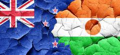 New zealand flag with Niger flag on a grunge cracked wall Stock Illustration