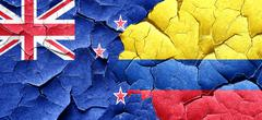 New zealand flag with Colombia flag on a grunge cracked wall - stock illustration