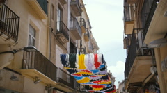 Gracia Festival Decorations in Spain. Street is decorated with hand residents of Stock Footage