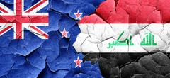 New zealand flag with Iraq flag on a grunge cracked wall Piirros