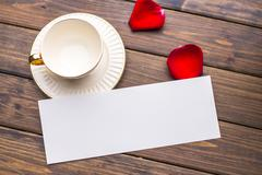 White blank card on tab le in cafe Stock Photos