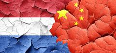 Netherlands flag with China flag on a grunge cracked wall - stock illustration