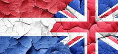 Netherlands flag with Great Britain flag on a grunge cracked wal - stock illustration