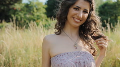 Caucasian lady stand in the field and smile Stock Footage