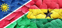 Namibia flag with Ghana flag on a grunge cracked wall Stock Illustration