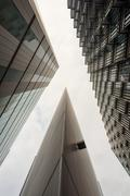 Tall modern business buildings in London City with a white sky and reflection - stock photo