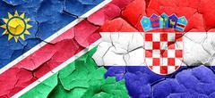 Namibia flag with Croatia flag on a grunge cracked wall Stock Illustration