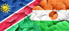 Namibia flag with Niger flag on a grunge cracked wall Stock Illustration