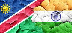 Namibia flag with India flag on a grunge cracked wall Stock Illustration