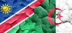 Namibia flag with Algeria flag on a grunge cracked wall Stock Illustration