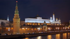 Cars are moving on Moscow river embankment near Kremlin wall Stock Footage