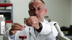 Scientist wearing lab coat working in laboratory Stock Footage