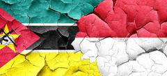 Mozambique flag with Indonesia flag on a grunge cracked wall Stock Illustration