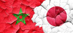 Morocco flag with Japan flag on a grunge cracked wall Stock Illustration