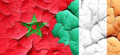 Morocco flag with Ireland flag on a grunge cracked wall Stock Illustration