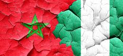 Morocco flag with Nigeria flag on a grunge cracked wall Piirros