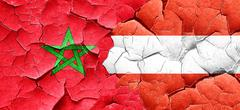 Morocco flag with Austria flag on a grunge cracked wall Stock Illustration