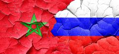 Morocco flag with Russia flag on a grunge cracked wall - stock illustration