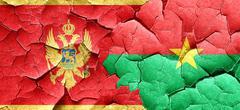 Montenegro flag with Burkina Faso flag on a grunge cracked wall Stock Illustration