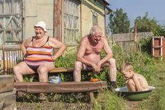 Family summer pastime in the old house with a garden - stock photo