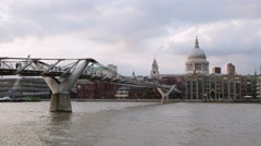 St Paul's cathedral and Millennium bridge in London in a cloudy afternoon Stock Footage