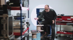 Electric Engineer in workshop cutting wire Stock Footage